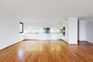 Empty apartment with a wood floor