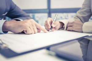 person signing a document