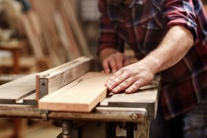 Carpenter using a table saw