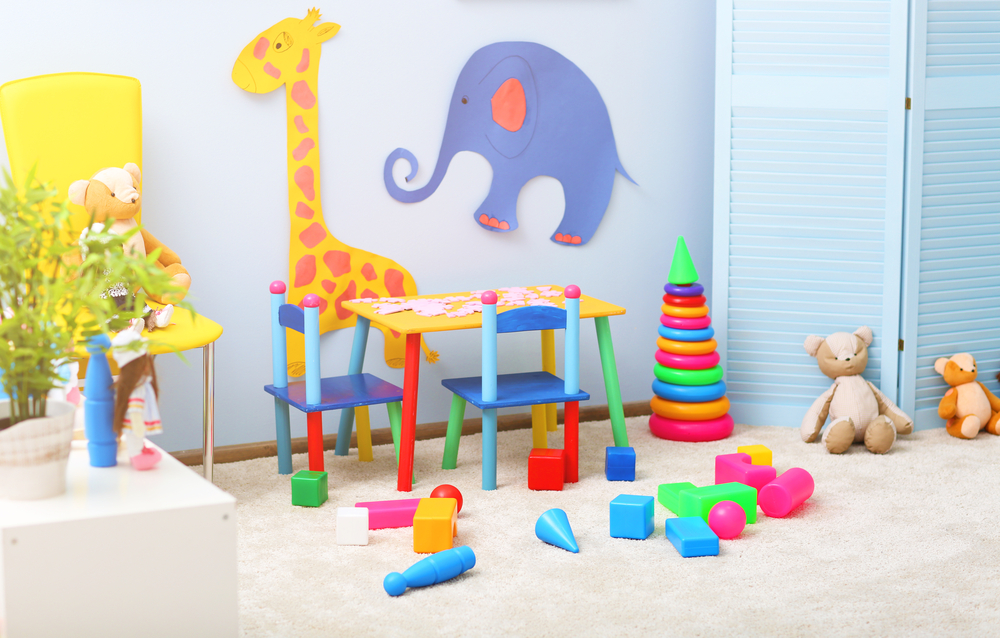 A children's play room is decorated with wild animals and toys.
